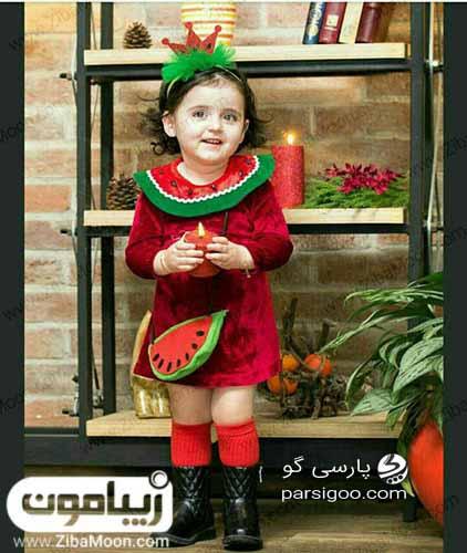 دختر بچه با لباس طرح هندوانه تم شب یلدا