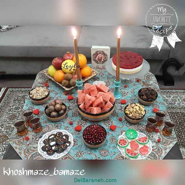 چیدمان جذاب سفره شب یلدا میوه و تنقلات و حافظ با شیرینی و چای